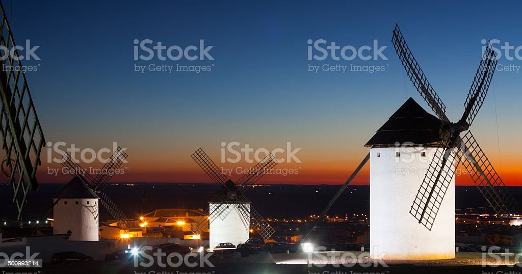 windmills in Campo de Criptana in sunset time stock photo