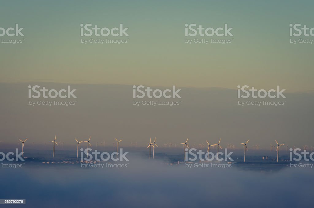 windmills in fog stock photo