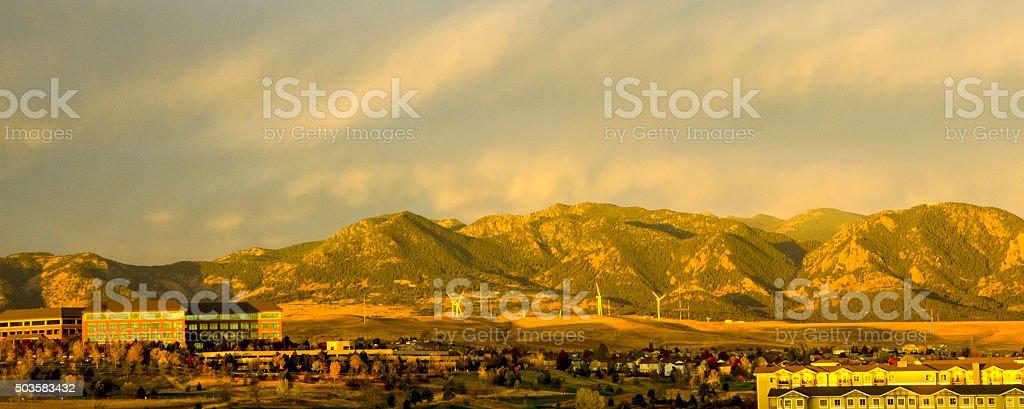 Windmills in Front of the Flatiron Mountain Range stock photo
