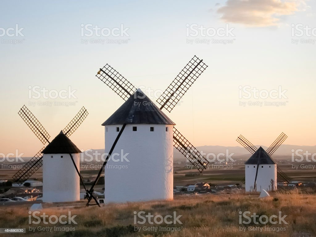 Windmills in La Mancha, Spain, at dusk. stock photo