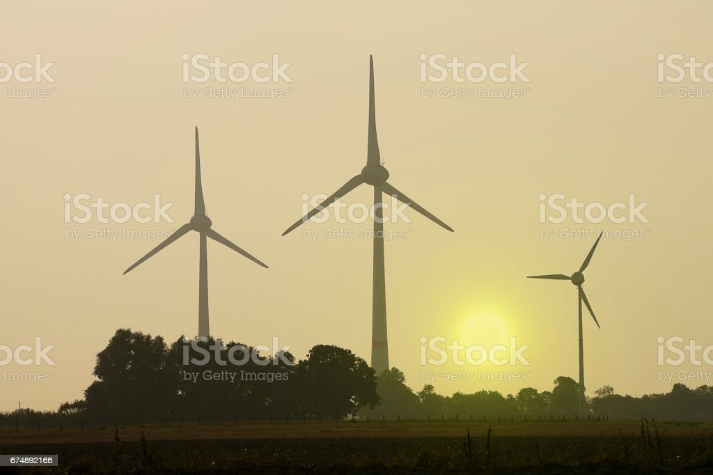 windmills in sunrise stock photo