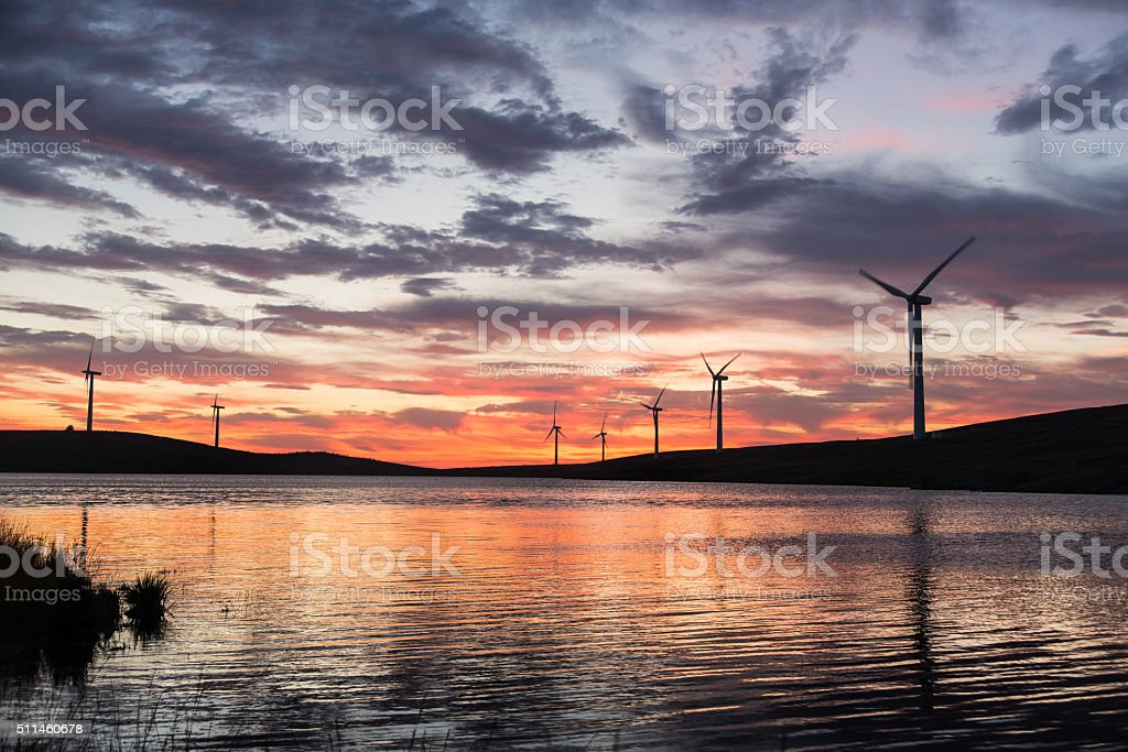 Windmills lake sunset Ireland stock photo