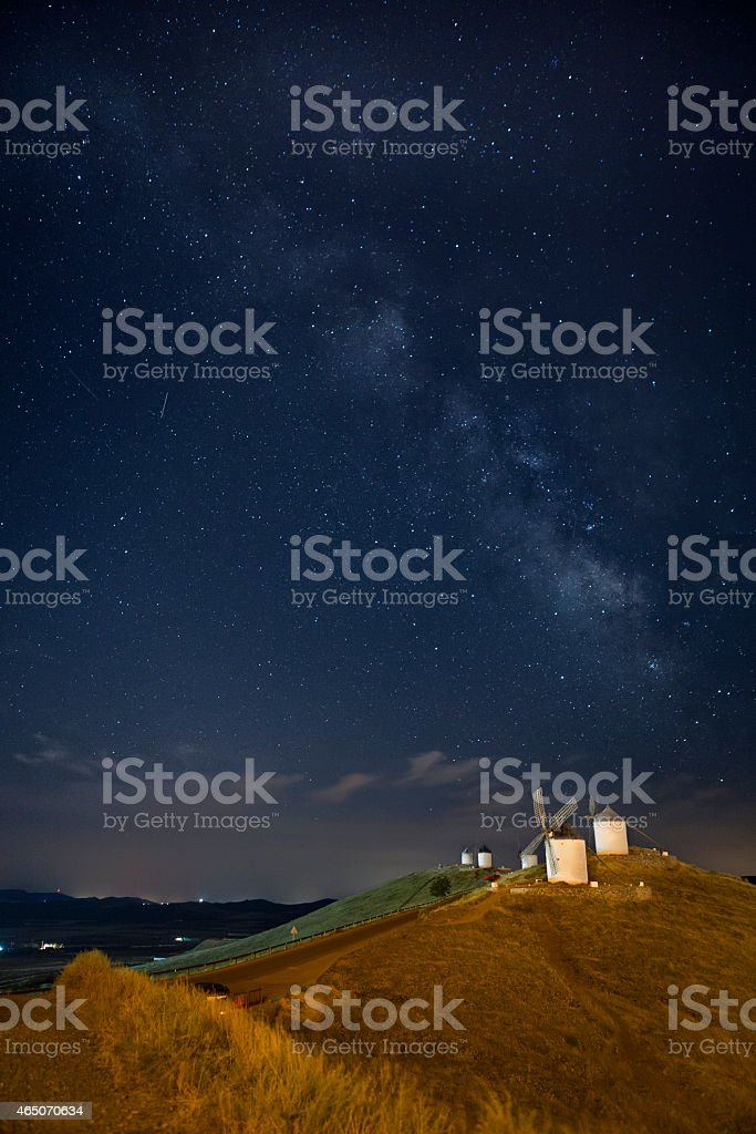 Windmills of Consuegra under Milky Way - La Mancha, Spain stock photo