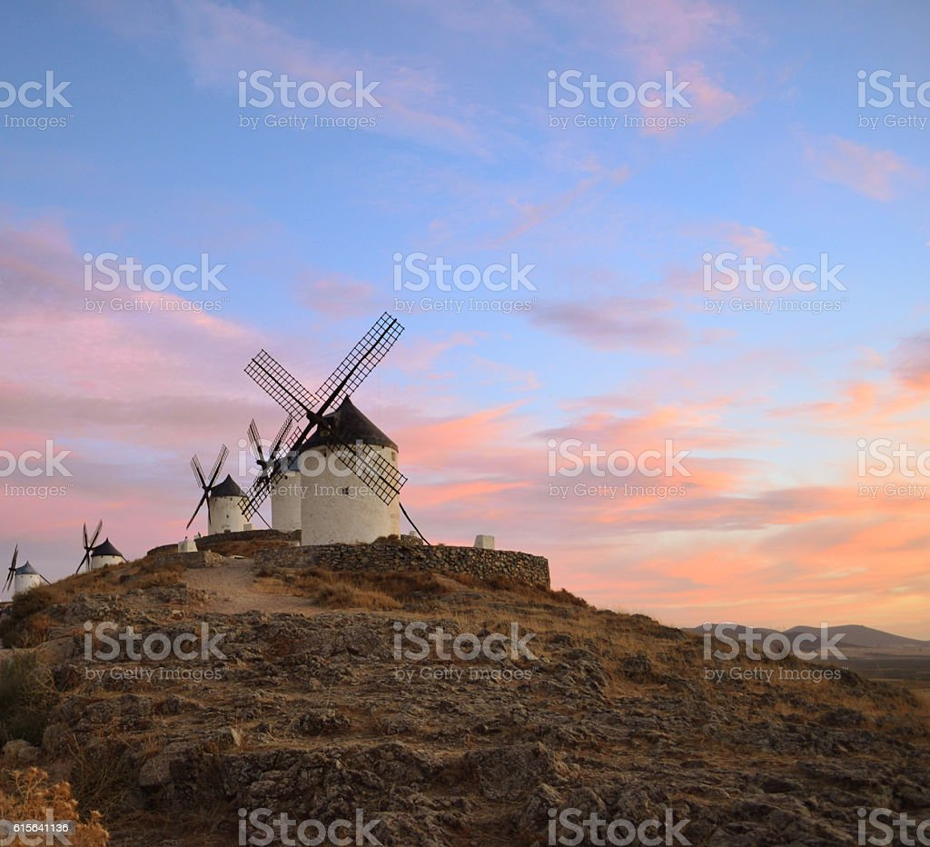 windmills of Consuegra with evening sky stock photo
