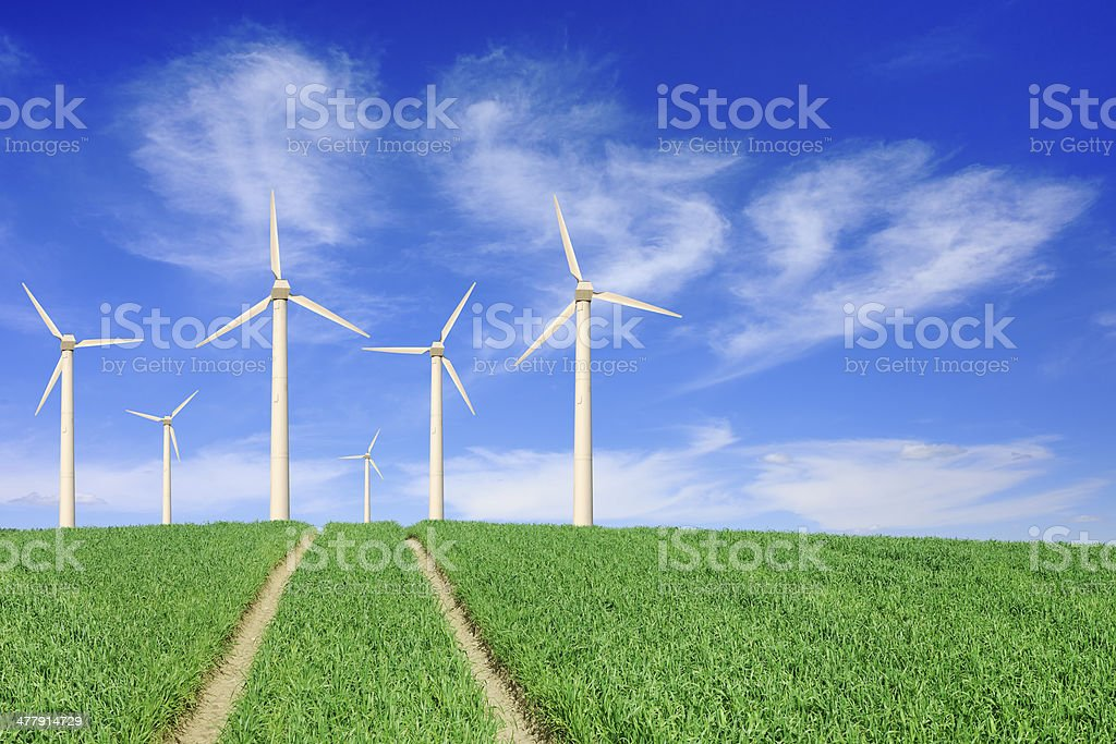 Windmills on green fields royalty-free stock photo