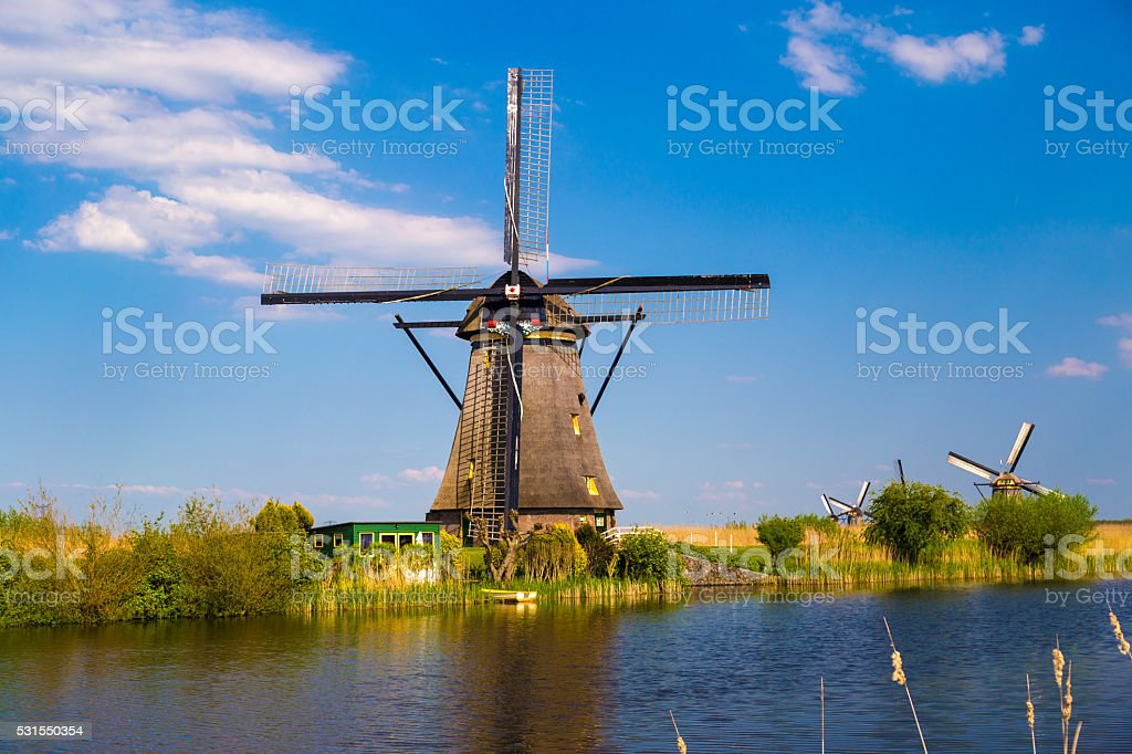 Windmills reflected in canals at Kinderdijk, the Netherlands stock photo