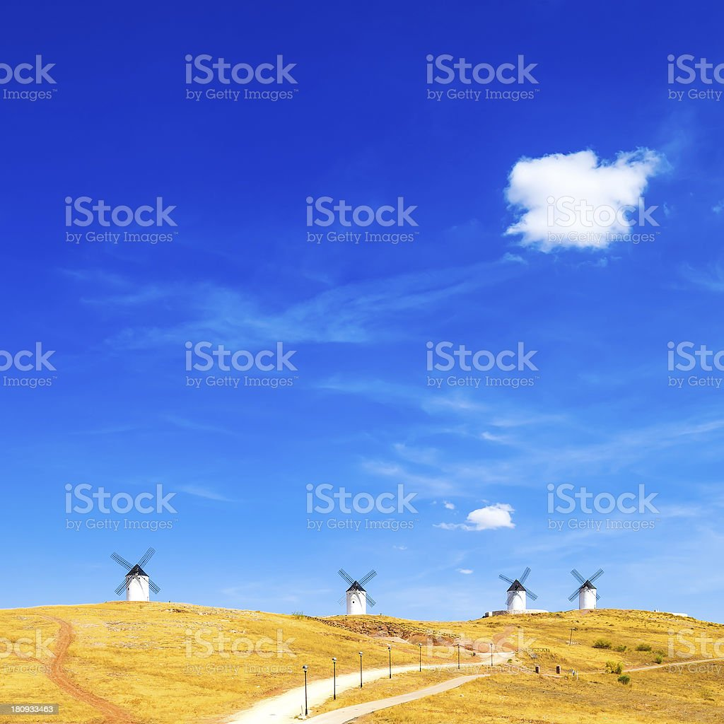 Windmills, rural fields and small cloud. Consuegra, Spain royalty-free stock photo