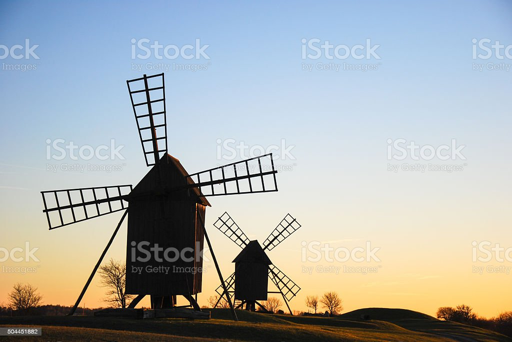 Windmills silhouettes stock photo