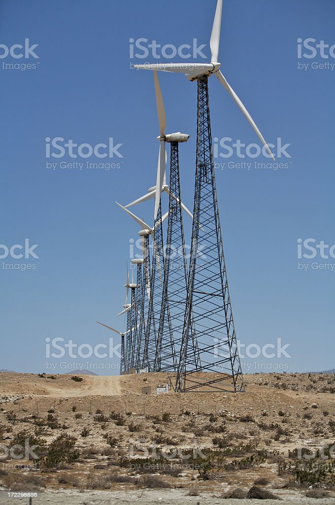 Windmills towering above stock photo