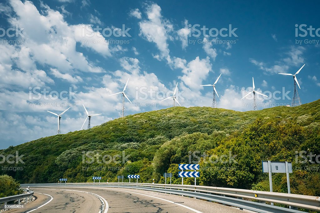 Windmills, wind turbines for electric power production stock photo