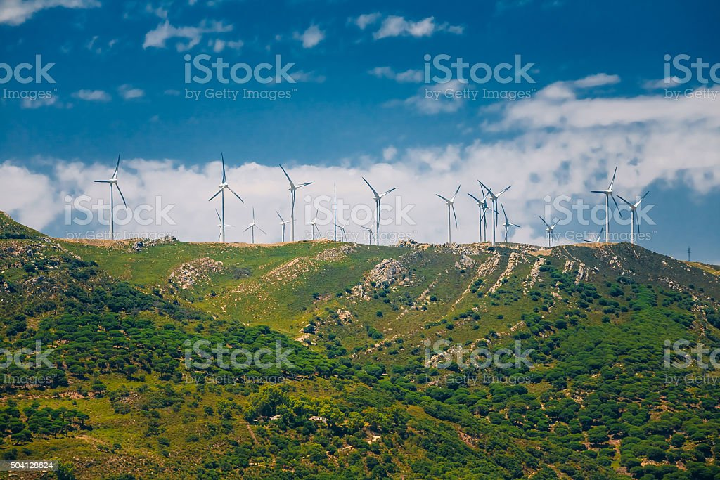 Windmills, wind turbines for electric power production working o stock photo