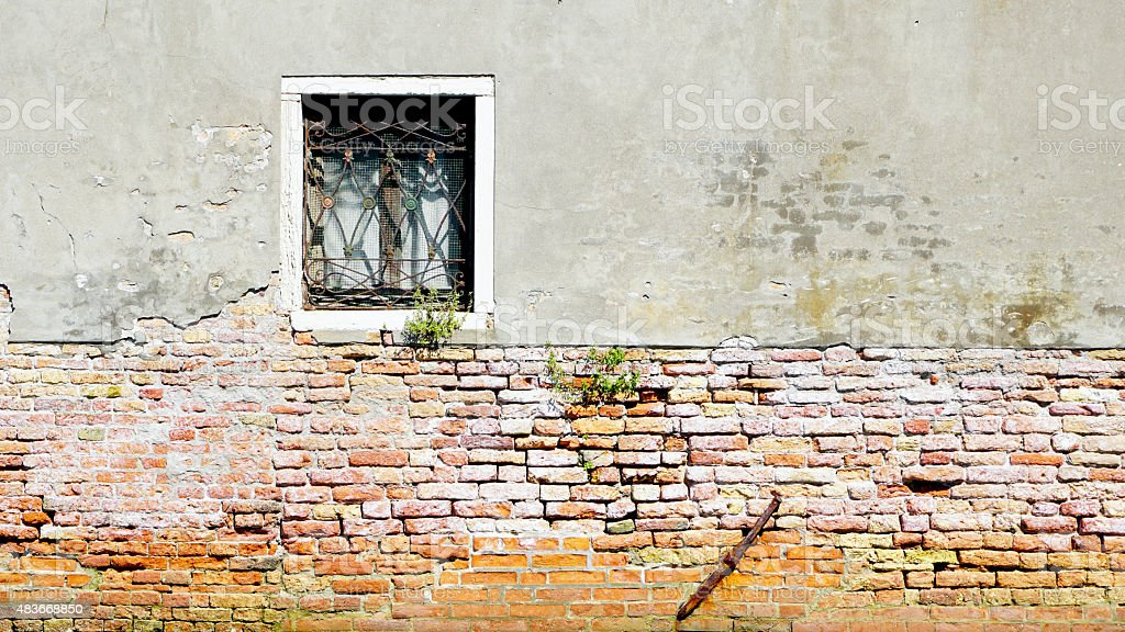 window and ancient decay wall half brick wall stock photo