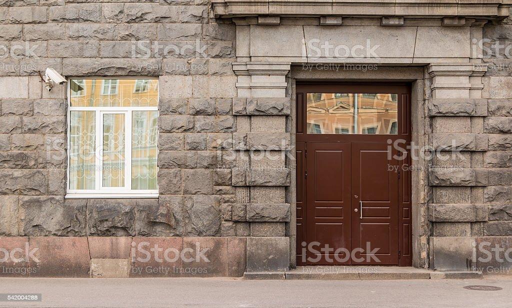 Window and door on facade of office building stock photo