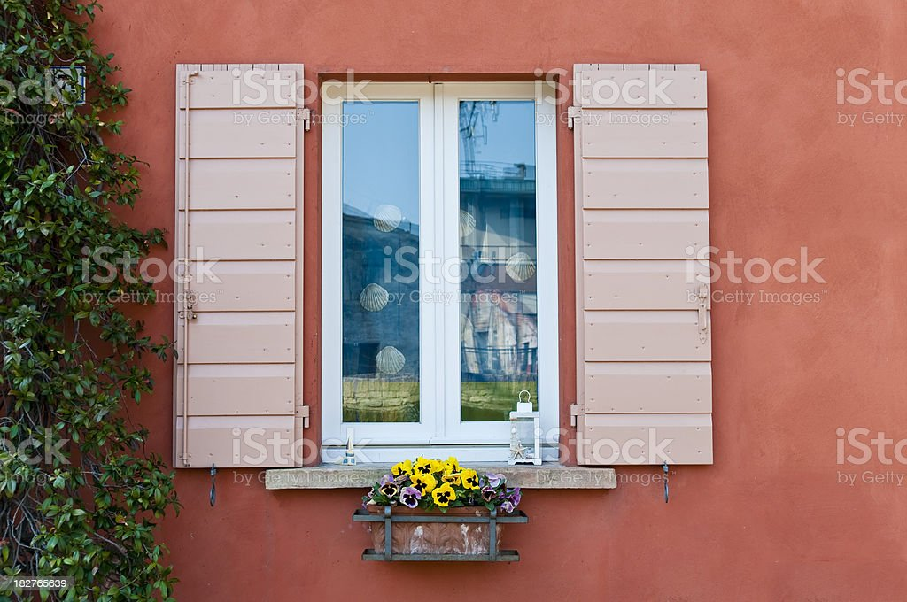 Window And Flowerpot On Brown Wall In Italy royalty-free stock photo