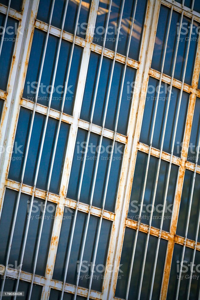 Window and grate textured royalty-free stock photo