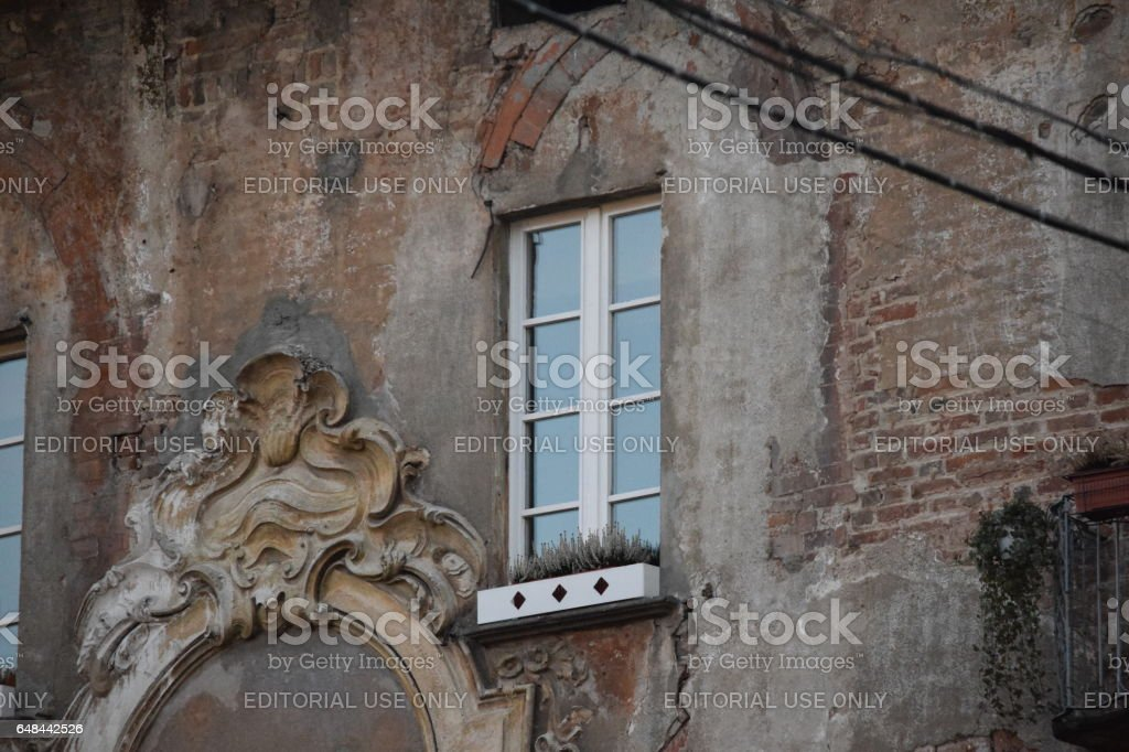 Window and particular of a stucco decoration. Contras ancient/cotemporary stock photo