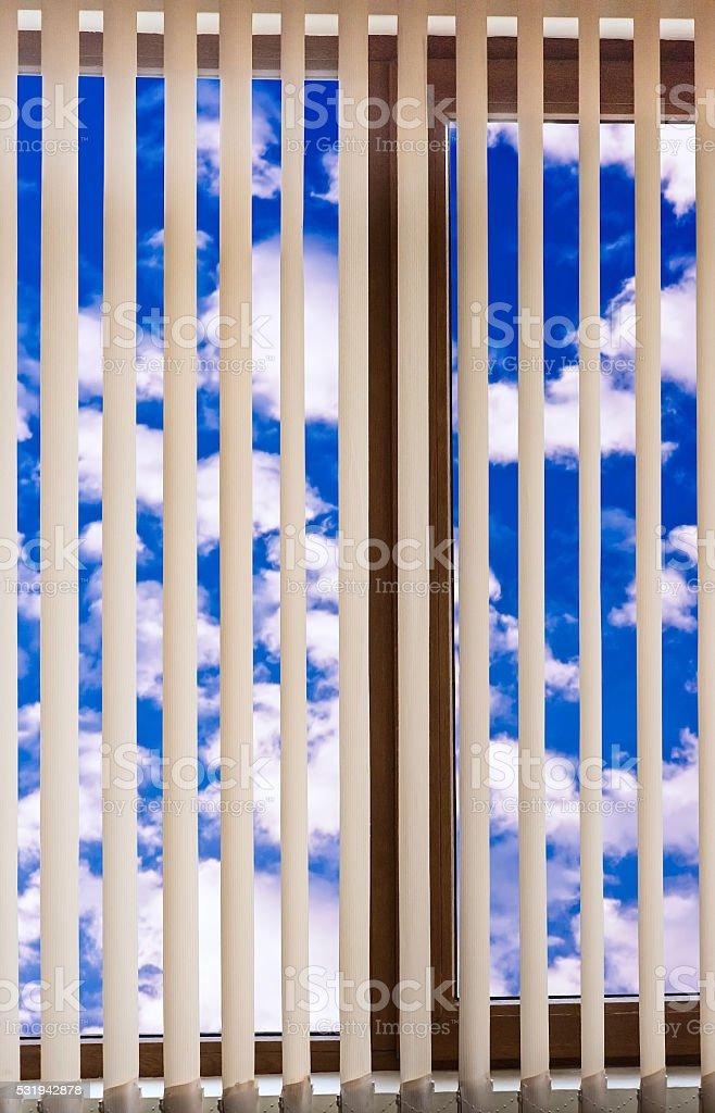 window blinds cloud sky stock photo