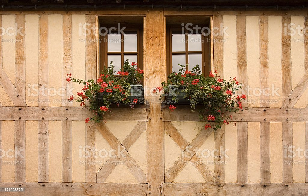 Window boxes full of flowers in Normandy stock photo