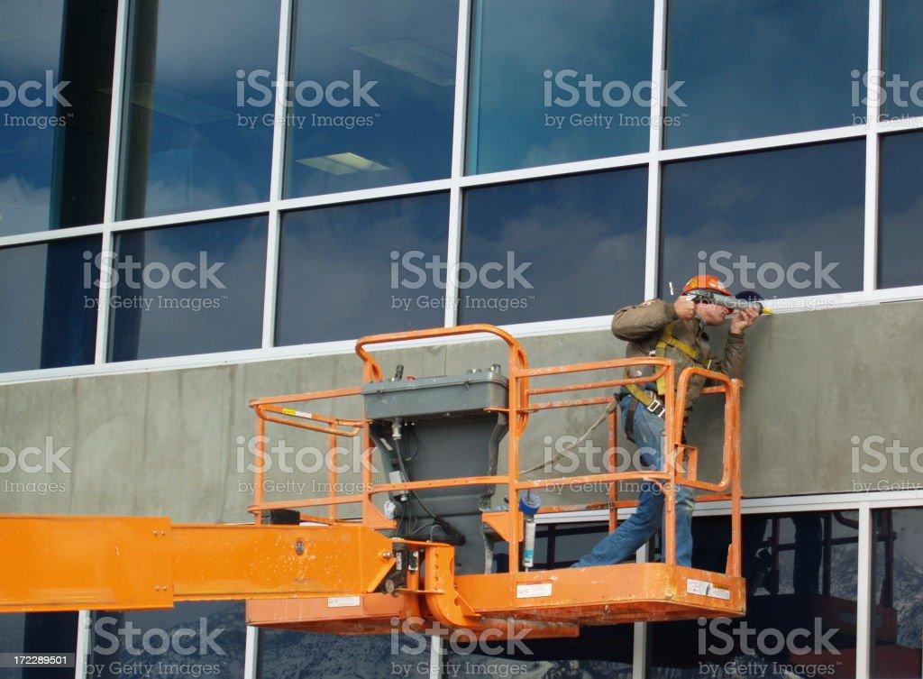 Window Caulking Construction Worker Man stock photo
