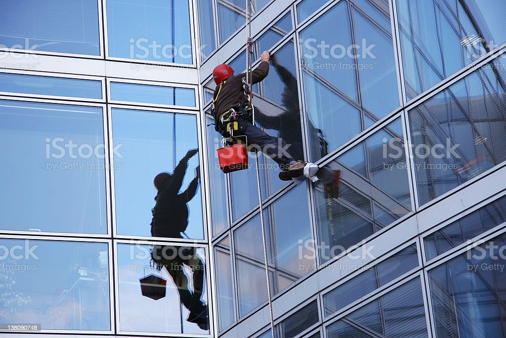 Window cleaner and offices building stock photo