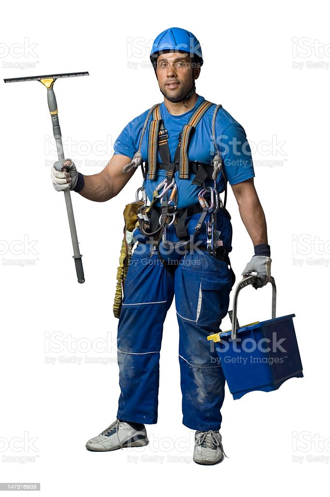 Window cleaner, dressed in blue, with a bucket and squeegee stock photo