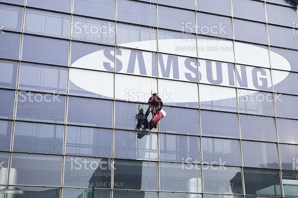 Window Cleaner on a Tall Skyscraper with Samsung Logo stock photo