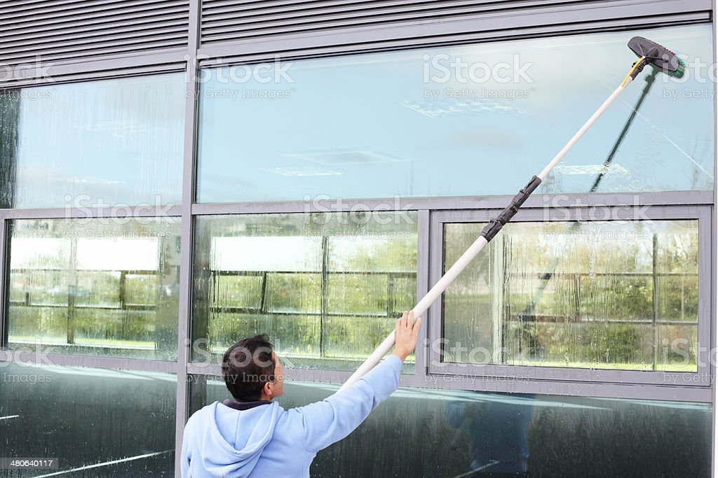 Window cleaner using the water fed pole system stock photo