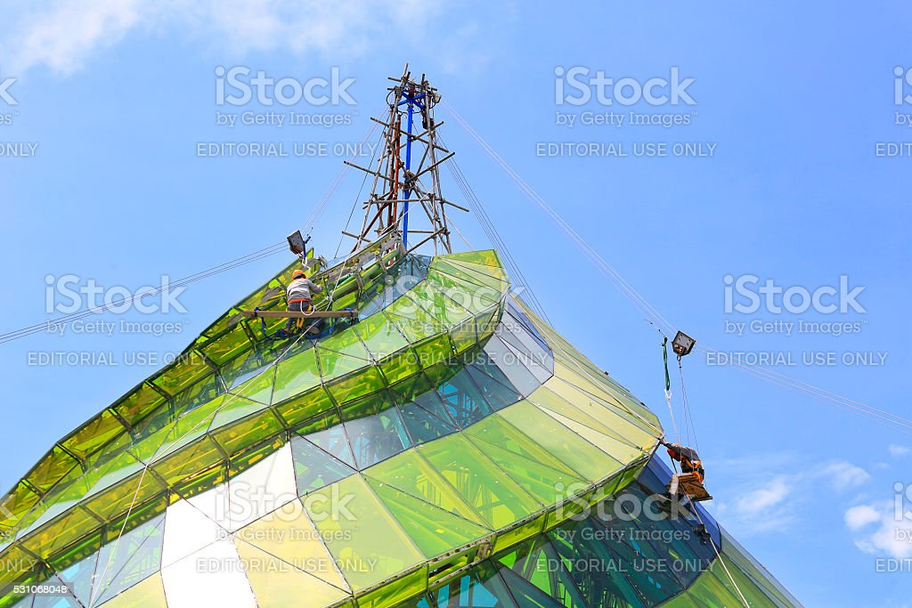 Window cleaner working on a glass facade stock photo
