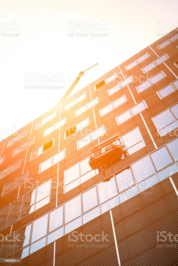Window cleaners on a skyscraper office building royalty-free stock photo