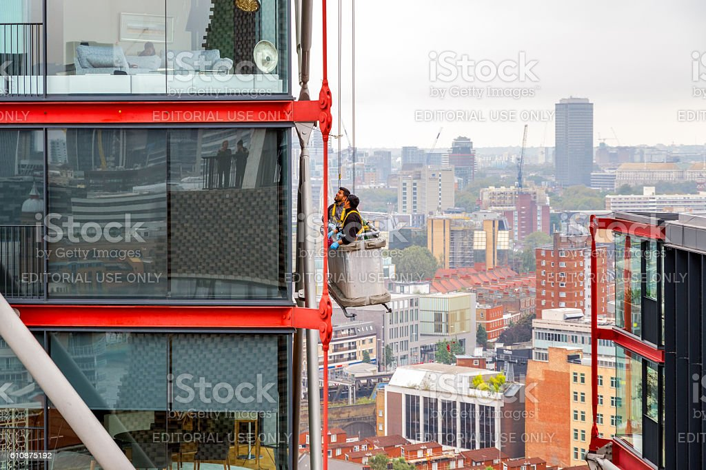 Window Cleaners Working on A High Rise Building stock photo