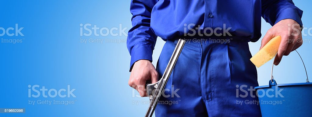 Window cleaning employee with work tools blue background stock photo
