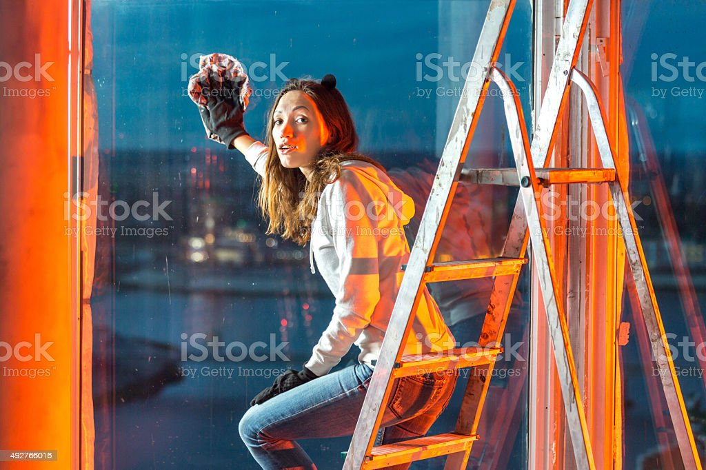 Window Cleaning From Charming Girl stock photo