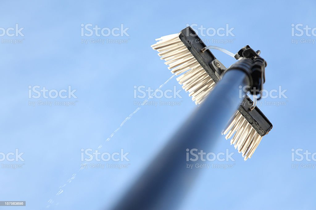 Window cleaning using the water fed pole system stock photo