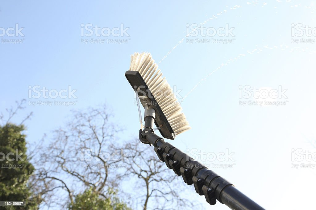 Window cleaning using the water fed pole system royalty-free stock photo