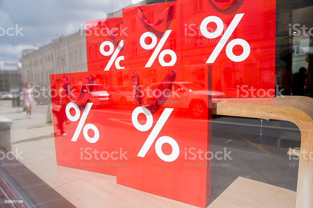 Window display with red shopping bags stock photo