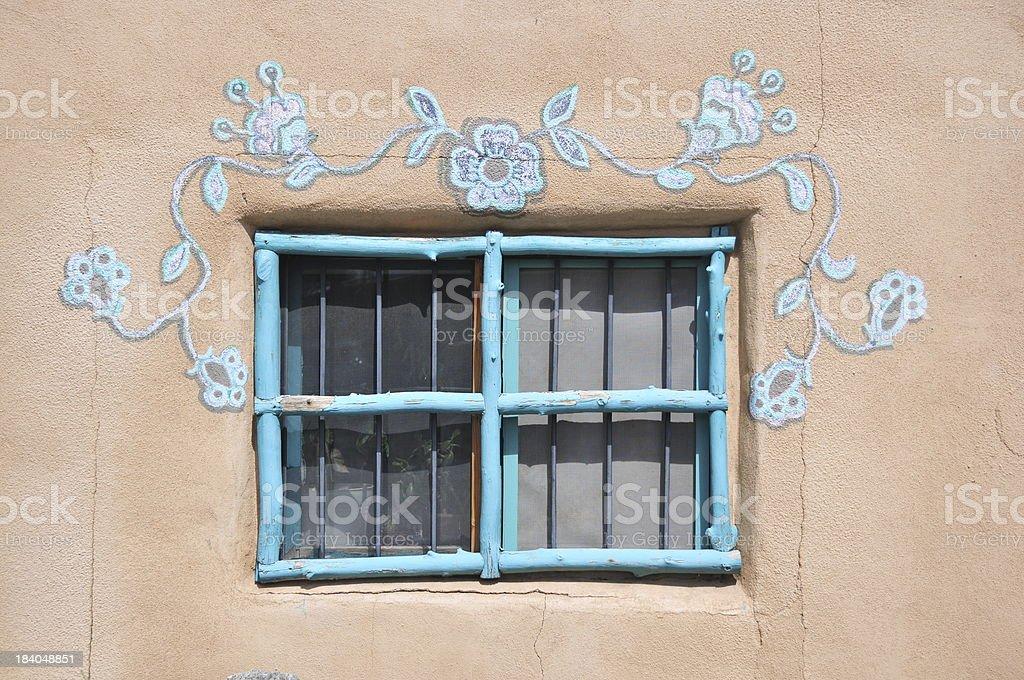 window framed by flowers stock photo