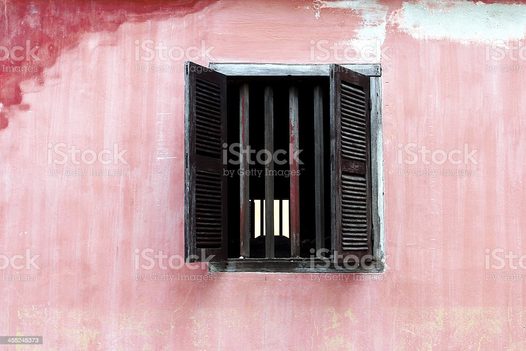 Window from a old house on pink wall,Vietnam stock photo