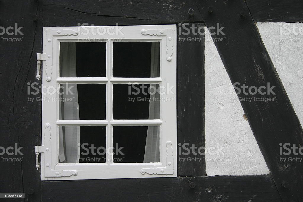 Window in a half-timbered house stock photo