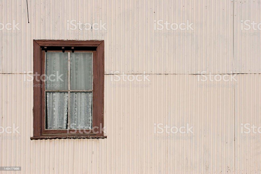 Window in a zinc metal wall royalty-free stock photo