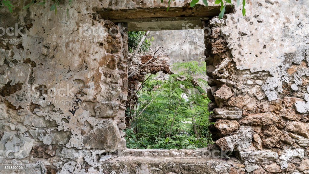Window in abandoned stone building stock photo