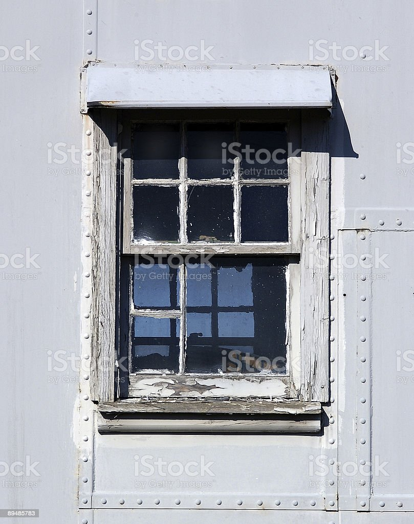 window in an abandoned train royalty-free stock photo