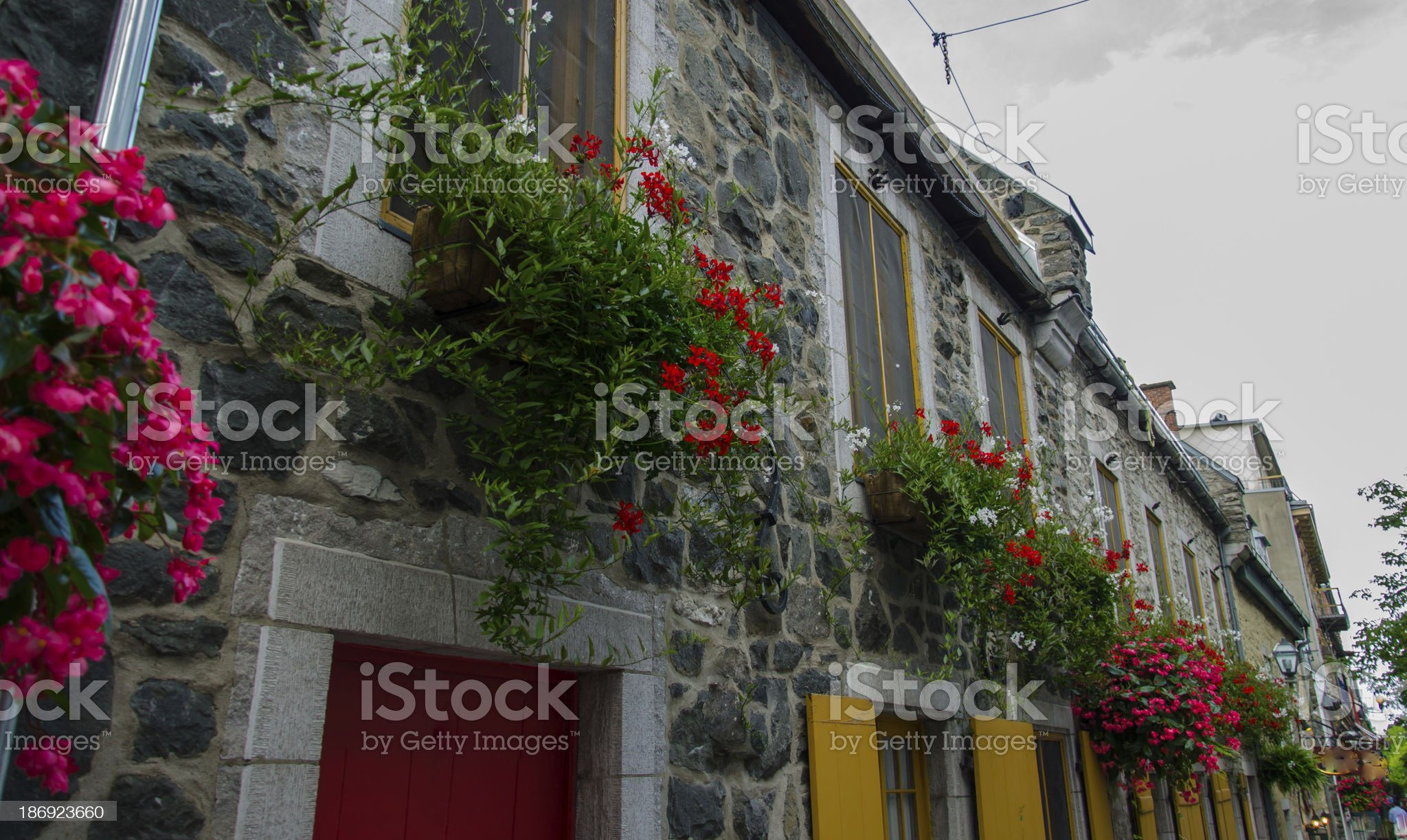 Window in stone wall with flowers, Old Quebec, Canada royalty-free stock photo