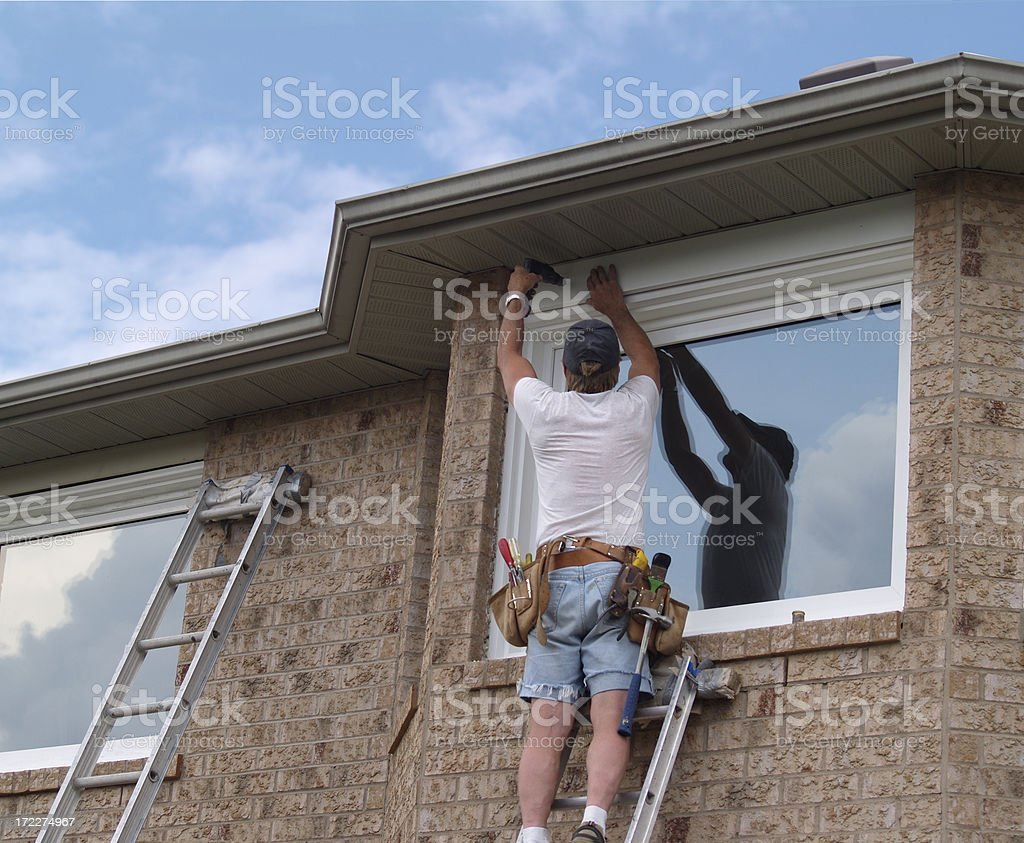 Window installation, contractor attaching trims around the newly installed window royalty-free stock photo