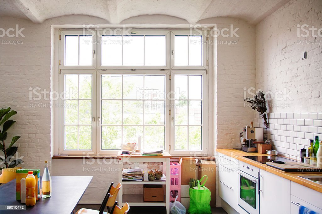 Window into sunny white European kitchen stock photo