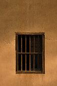 Window lattice on mud wall