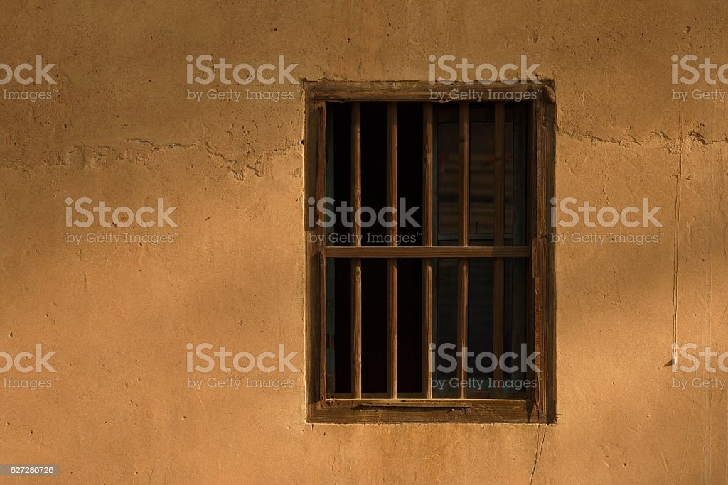 Window lattice on mud wall stock photo
