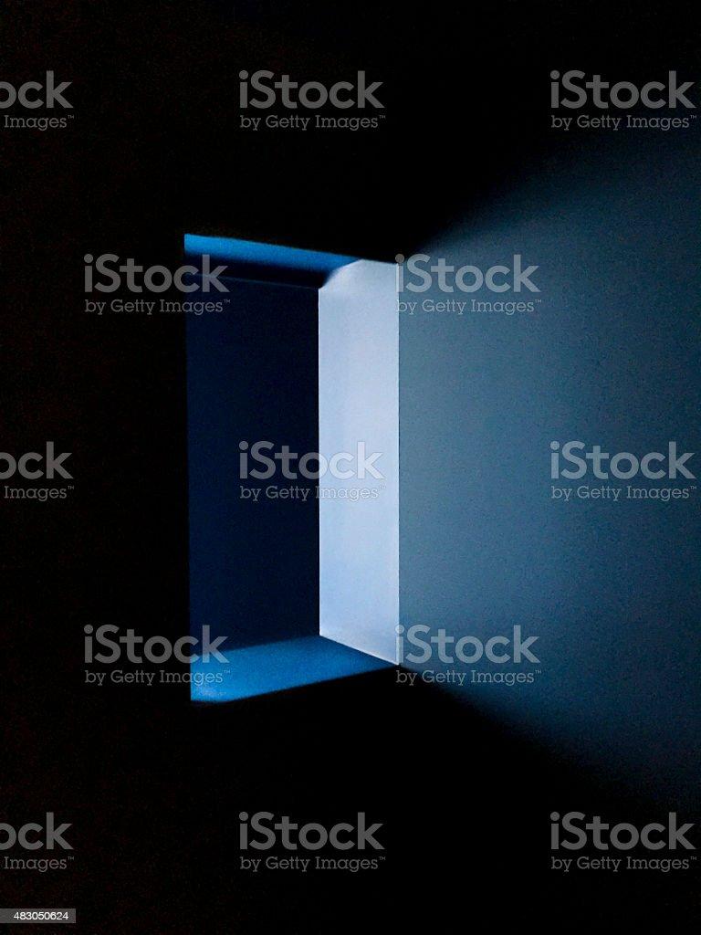 Window light in dark room stock photo