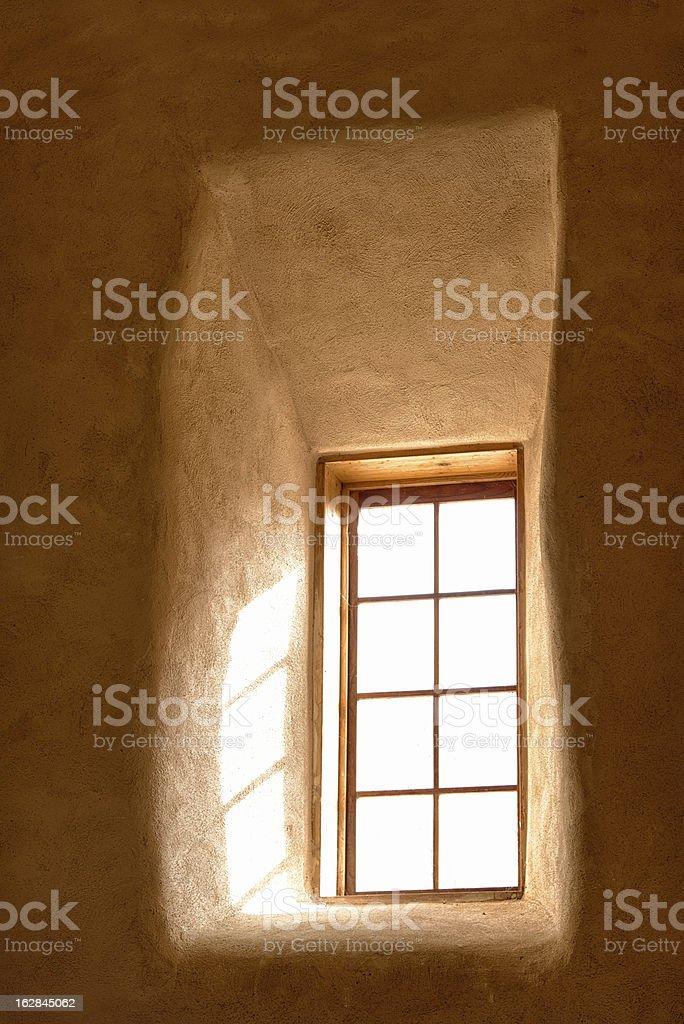 Window light through adobe wall stock photo