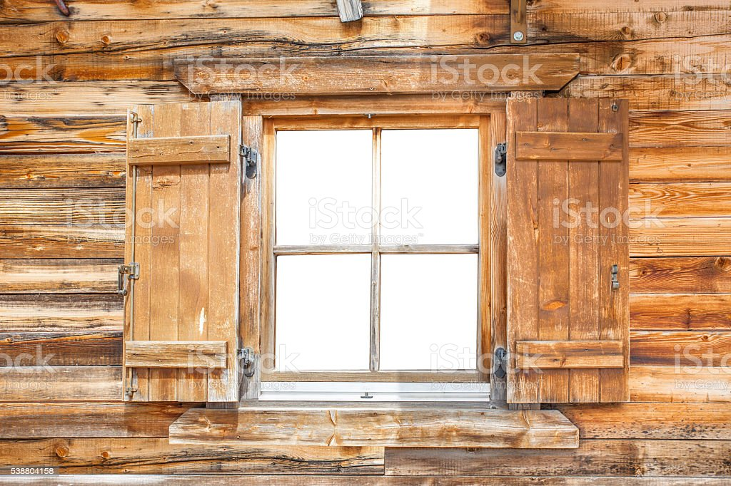 Window of a mountain cabin stock photo