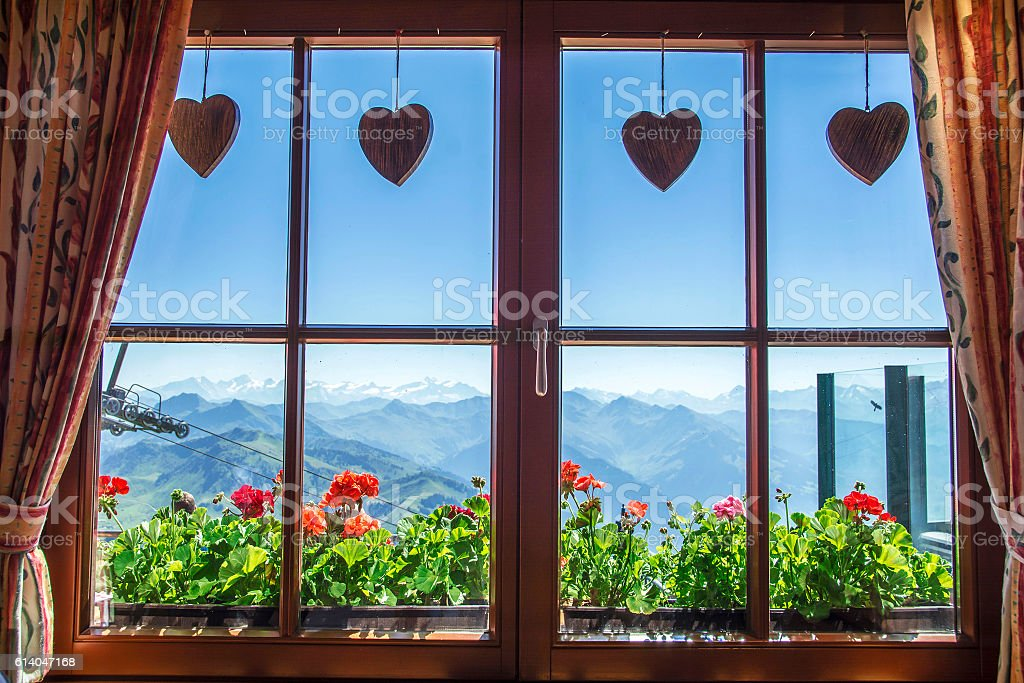 Window of alpine cottage, Tirol, Austria stock photo